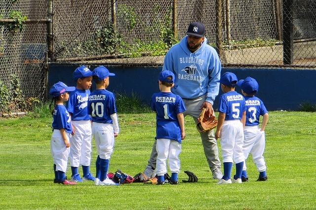 image of a coach and youth baseball players